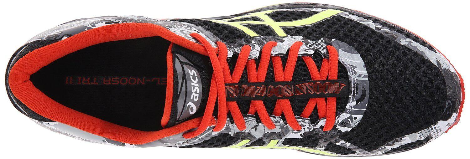 the Asics Gel Noosa Tri 11 uses a printed overlay system on the upper to reduce weight