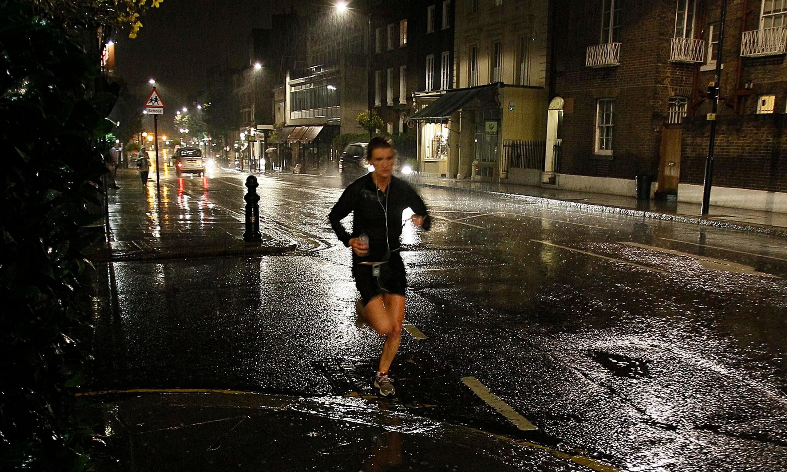 Runner in London street at night