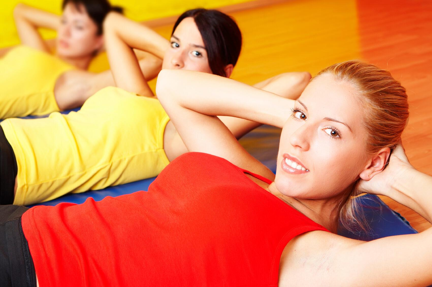 Group of young attractive girls exercise fitnes at club