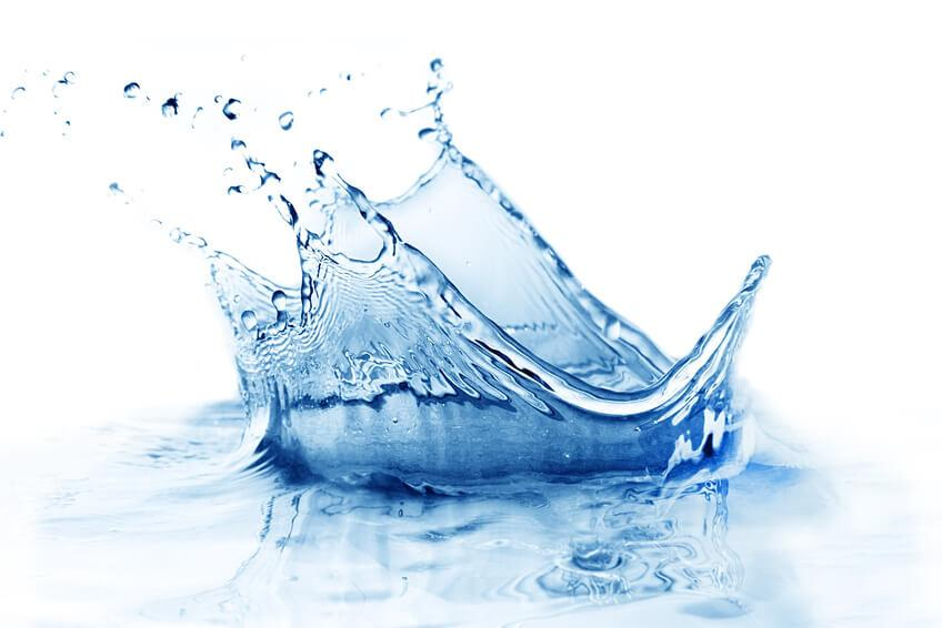 Fresh clean water splash in blue.