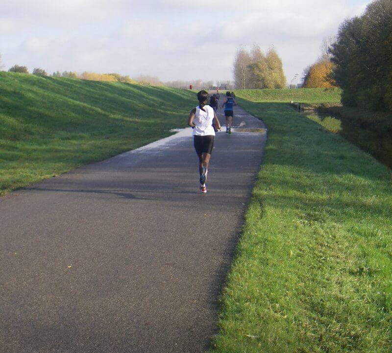 black_female_running_on_a_road