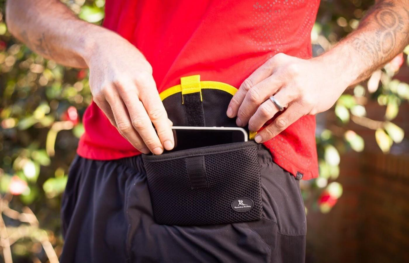 the buddy pouch has strong magnets that connect to the waist band of your pants or shorts