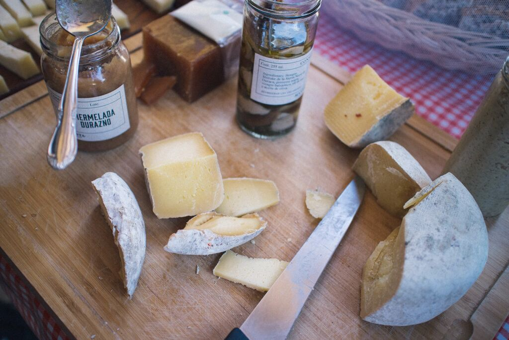 board of cheese with knives