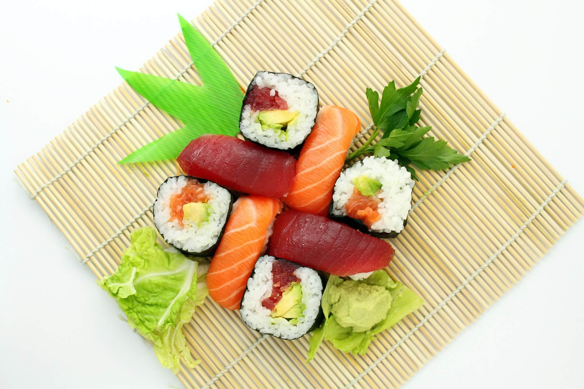 a plate of colourful sushi
