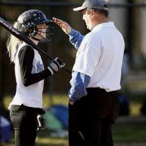 private trainer for baseball instructing a girl at practice