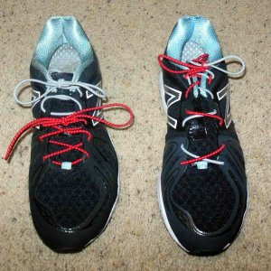 two sets of laces for running shoes
