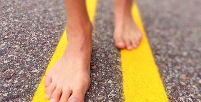 Barefoot runner: feet on the road